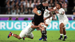 Billy Vunipola and two of his England team-mates swarm around New Zealand's Brodie Retallick