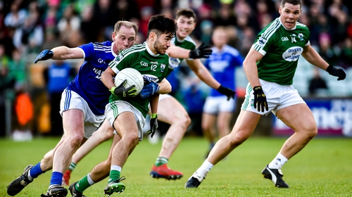 Naoise O'Baoill of Gaoth Dobhair in action against Anthony Thompson of Naomh Conaill