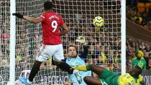 Anthony Martial scores the third for United