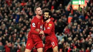 Liverpool goalscorers Jordan Henderson and Mohamed Salah celebrate at Anfield