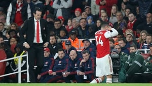 Unai Emery watches as Granit Xhaka takes off his shirt and walks straight down the tunnel after being substituted