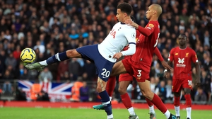Dele Alli is tackled by Liverpool's Fabinho