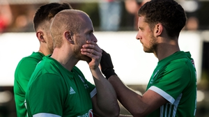 Eugene Magee (L) and Jonathan Bell react after losing to Canada