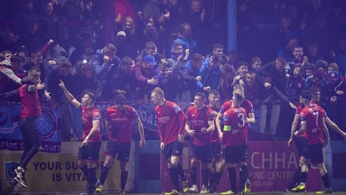 Chris Lyons of Drogheda United, extreme right, celebrates with team-mates and supporters