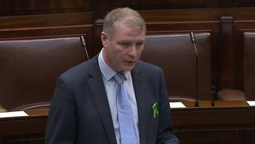The car at Martin Kenny's home was burned out