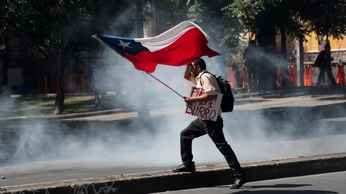 The announcement of a cabinet reshuffle came amid fresh protests outside the presidential palace in central Santiago