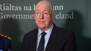 Charlie Flanagan said there were too many people in direct provision 'for too long a time'
