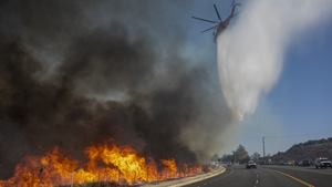 Homes and cars have been destroyed throughout the region as wildfires blaze