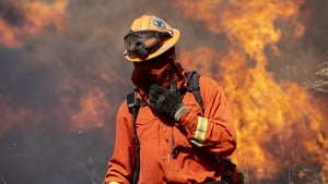 A firefighter near the Ronald Reagan Library as the blaze spreads near Simi Valley, North of Los Angeles