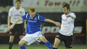 Dundalk's Greg Bolger battles for possession against Linfield's Robert Garrett during a 2011 Setanta Cup clash