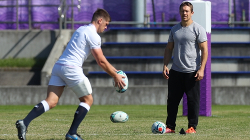 England captain Owen Farrell practises his drop-kicks as Jonny Wilkinson looks on