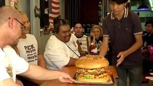 Restaurant owner Komdech Kongsuwan claims it's the biggestburgerin Thailand