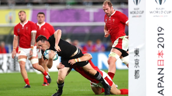 Ben Smith crosses for New Zealand in the first half against Wales in Yokohama