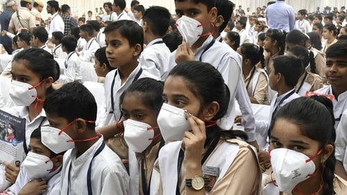 Millions of masks have been offered to children to protect them from the smog