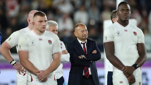 Eddie Jones watches the presentation alongside his players
