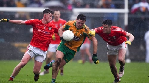 Dylan Wall of Corofin tries to burst past Ben O'Connell, left, and Conor Rhatigan of Tuam Stars