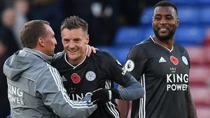 Brendan Rodgers (L) congratulates Jamie Vardy after Leicester's win