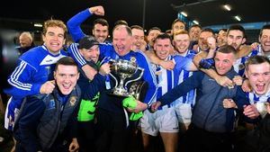 Ballyboden St Enda's players and officials celebrate with the cup