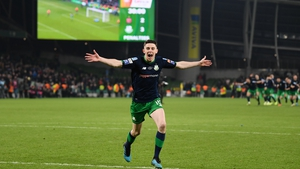 Gary O'Neill of Shamrock Rovers wheels away on celebration after scoring the winning penalty