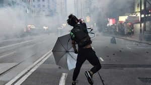 A protester in action after the police fired tear gas during a pro-democracy rally in Hong Kong