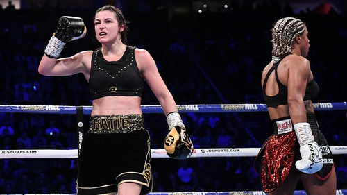 Katie Taylor (L) celebrates at the end of her WBO Super-Lightweight world title fight with Christina Linardatou