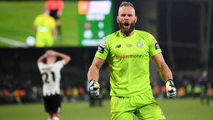 Alan Mannus celebrates with the Shamrock Rovers fans behind his goal during the penalty shootout