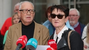 Patric and Geraldine Kriégelread a short statement outside the court
