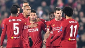 Alex Oxlade-Chamberlain is mobbed after his winner