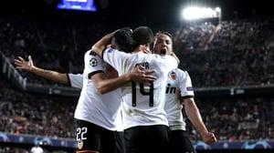Maximiliano Gomez, Jose Luis Gaya and Manu Vallejo celebrate Valencia's second goal