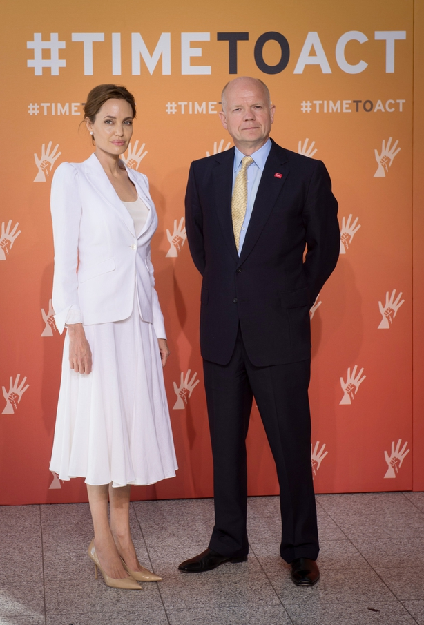 Jolie in 2014 with foreign secretary of the time William Hague (Stefan Rousseau/PA)