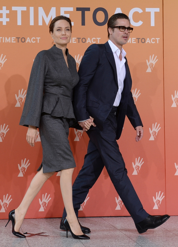 Angelina Jolie and Brad Pitt arrive at the End Sexual Violence in Conflict Summit(Stefan Rousseau/PA)