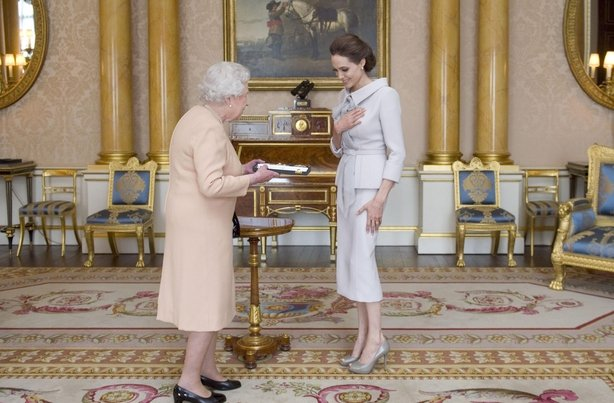 The Queen presents Jolie with an order of chivalry (Anthony Devlin/PA)