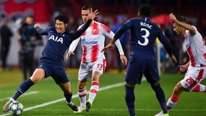 Son Heung-min stretches to keep the ball in play in Belgrade