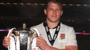 Dylan Hartley picking up the Six Nations trophy in Dublin in 2017