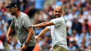 Jurgen Klopp (L) and Pep Guardiola do battle again this Sunday
