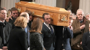 Gay Byrne's coffin is carried into Dublin's Pro Cathedral