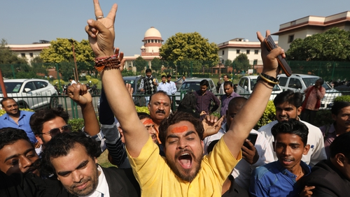 A Hindu devotee reacts after the announcement of the verdict