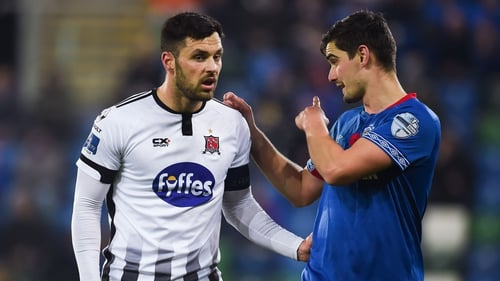 Dundlak's Pat Hoban exchanges views with Jimmy Callacher of Linfield