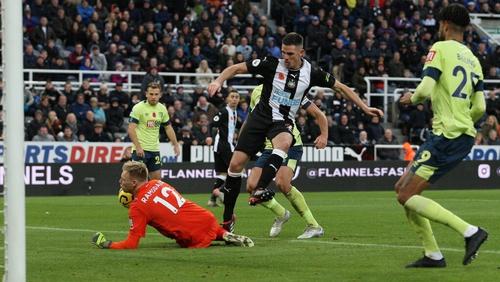 Ciarán Clark taps home his goal against Bournemouth