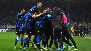 Inter players celebrate their late winner at the San Siro
