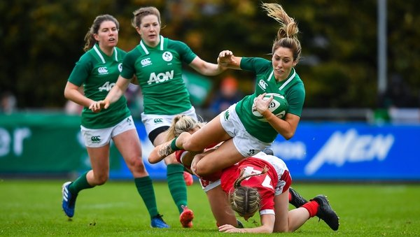 Ireland winger Eimear Considine is tackled by Alecs Donovan, left, and Paige Randall at the UCD Bowl