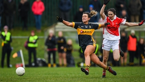 Mourneabbey's Doireann O'Sullivan gets a shot off despite the attentions of Donaghmoyne's Fiona Courtney