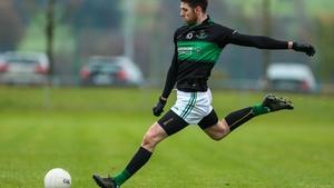 Luke Connolly of Nemo Rangers kicks a free