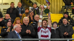 Christopher McKaigue raises the Four Seasons Cup aloft