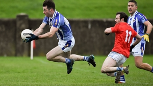 Michael Darragh Macauley of Ballyboden St Enda's is fouled for a penalty