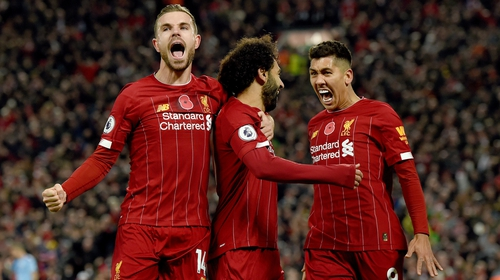 Liverpool celebrate their second goal at they beat Man City in Anfield