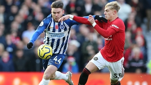 Aaron Connolly battles for possession with Manchester United's Brandon Williams