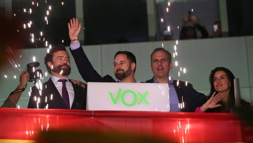 Vox party members including leader Santiago Abascal celebrate in Madrid