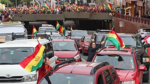 Bolivians celebrate the resignation of President Evo Morales, in La Paz, Bolivia
