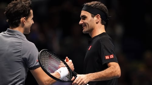 Dominic Thiem is congratulated by Roger Federer at the O2